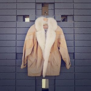 Tan suede jacket with fur lined collar.